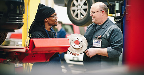 photo of two people talking in an auto shop