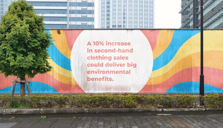 """Colorful image of a wall in a downtown setting that states """"A 10% increase in second-hand clothing sales colud deliver big enviromental benefits."""