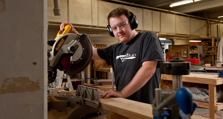 Photo of a student using a miter saw.