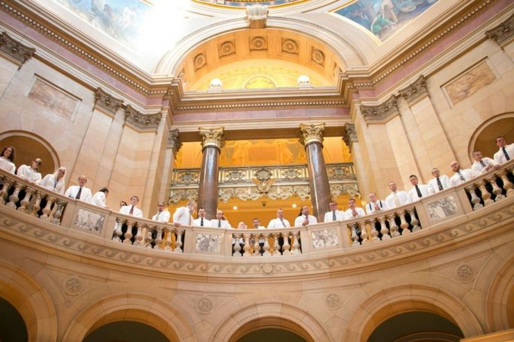 MN Adult and Teen Challenge choir look down from second level of Capitol Rotunda.